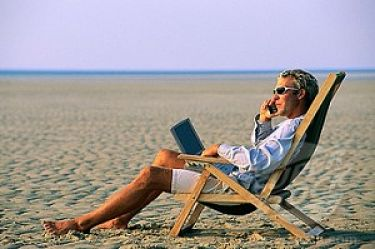 man-plugged-in-on-beach-300x199_opt